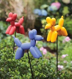 Set Of 3 Balloon Dog Resin Garden Stakes by Plow & Hearth. $29.95. Makes a great gift. Whimsical, fun, colorful. One each of blue, red and yellow. Resin balloon dog garden stakes, set of 3. Look like twisted balloon art, but made of durable, all-weather resin. These fun-loving resin pups look like whimsical twisted balloon art, but these guys are in no danger of popping, deflating or flying away. Our Set Of 3 Balloon Dog Resin Garden Stakes shows your whimsical side and make...