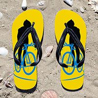 Triathlon Cyclist on Yellow Flip Flops - Kick back after a triathlon with these great flip flops! Fun and functional flip flops for all triathletes.