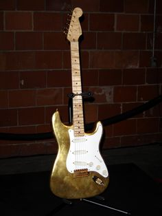 Eric Clapton's Gold Leaf Guitar designed by FENDER Master Builders Mark Kendrick and John Luis Campo. Presented to Clapton in 1996 to celebrate Fender's 50TH Anniversary. Eric used it on tour for two years.