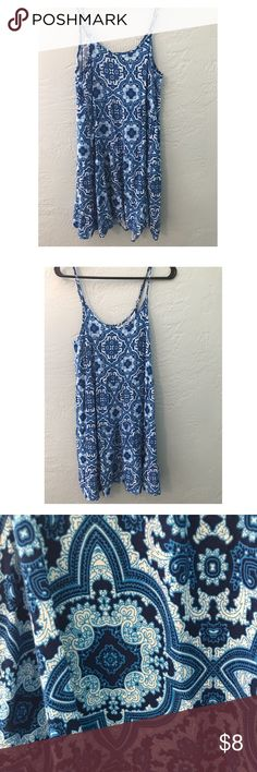 Blue Dress Flowy short blue dress from Target. Pretty pattern and adjustable straps make this a really comfortable piece. Colors are bright and condition is great.   Tags: festival summer beach beautiful fun surf boho Mossimo Supply Co. Dresses Mini