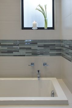Simple tile accent. Love the muted blue grays of this one. And the square tub with small lip is pretty as well.
