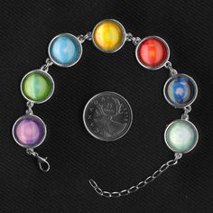 Final Fantasy 7 materia glass and metal bracelet on Etsy for $25.