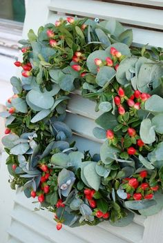 Baby Eucalyptus and red hypericum berries wreath., Baby Eucalyptus and red hypericum berries wreath. Perfect for the Aussie Christmas. by Vita Ranunkler. Aussie Christmas, Australian Christmas, Noel Christmas, Green Christmas, Christmas Door Wreaths, Christmas Flowers, Christmas Decorations, Deco Floral, Arte Floral