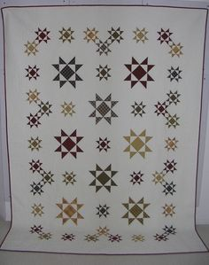 I don't know where this photo comes from - etsy it said but didn't come up. I love these plaid fabric stars with the square in a square centers... and how she arranged them.