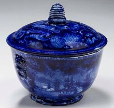 """Northeast Auctions - THE COLLECTION OF CHESTER CREUTZBURG AND DAVID MARTIN - PART ONE. 3/5/16.  Lot 125: COMMODORE MACDONNOUGH'S VICTORY: FLORAL BORDER-IRREGULAR CENTER,' STAFFORDSHIRE DARK BLUE TRANSFER-PRINTED SUGAR BOWL AND COVER, ENOCH WOOD & SONS, BURSLEM, 1819-46. Estimated Price: $400 - $600. Realized: $840 (700).  Description: The bowl affixed with lion's mask handles, the view on the cover printed """"MAC DONNOUGH'S VICTORY,"""" with beehive knop. Height 4 5/8 inches. Provenance: William…"""
