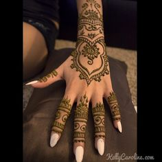 edding Henna on the top of a hand for a lovely bride