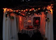 Happy Sukkot to my Jewish brothers and sisters. Here's a sukkah made with a portable gazebo, lights, antique quilt, art, willow branches and autumn decor. Lovely for a pleasant Sukkot fall evening.