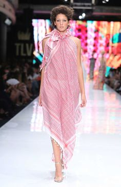 Yaron Minkovsky: Another well-established Israeli designer who's been in business for decades, Minkovsky raised some eyebrows for this dress, which is made from a keffiyeh, a traditional Palestinian scarf. Whether he intended to make a political statement with the piece, it looked truly beautiful coming down the runway. Photo: Avi Valdman/Tel Aviv Fashion Week.