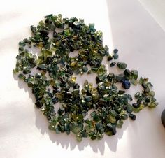 Typical natural rough sapphire - in yellows and greens - from Capricorn Sapphire.