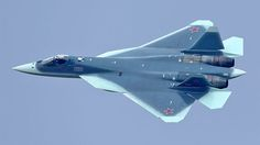 """A new photo captured by Artyom Anikeev shows Russia's new Sukhoi T-50 stealth fighter—the F-22 Raptor's nemesis. According to The Aviationist, its new camouflage—inspired by a typical white tip Red Sea's shark—will make it look """"as a rhomboidal shaped aircraft, smaller than the actual airplane"""" from a distance."""