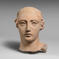 Terracotta head of a young man  Classical period,4th century BC  Greek,South Italian,Tatentine.