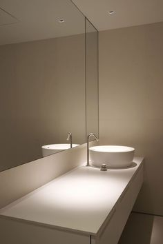 What about large, to the ceiling mirrors? It'd make the bathroom seem bigger.