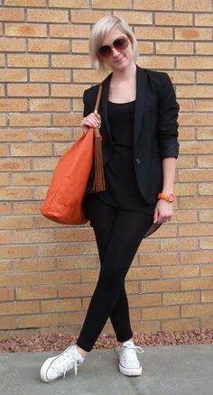 black outfit with converse trainers and pop of orange