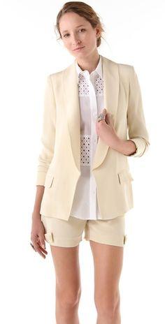 cream blazer and shorts