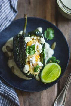 Roasted Poblano Chiles Stuffed with Cheesy Butternut Squash Quinoa + Pepita Crema