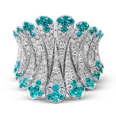 How amazing is this ring?! Diamond and Paraiba tourmaline right hand ring.