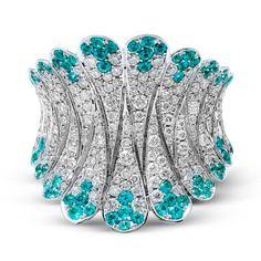 Diamond and Paraiba tourmaline right hand ring.