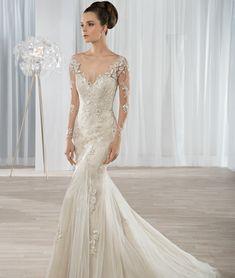Demetriosbride Beautiful lace mermaid gown with long sleeves illusion Low back www.uniquebridalandboutique.com