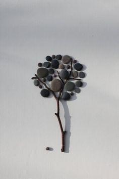 Поделки из речной гальки: минималистичные картинки для украшения стен. Фото   Своими руками