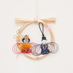水引の和リース 雛飾り│和工房 包結 オンラインショップ Wire Crafts, Diy And Crafts, Paper Crafts, Japanese Ornaments, Hina Dolls, Weaving Designs, Child Day, Weaving Art, Japan Art