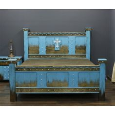 Domingo Azul Bed has silver nail heads designed with scalloped raised wooden overlays.  A silver finished wrought iron cross adds the finishing touches to this western bed. #westernfurniture