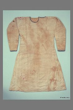 Tunic Date: 6th–7th century. Geography: Egypt, Akhmim (former Panopolis). Culture: Coptic. Medium: Linen, wool, and silk. Dimensions: 40.5 in. high 62.00 in. wide (102.9 cm high 157.5 cm wide). Classification: Textiles. Credit Line: Gift of George F. Baker, 1890. Accession Number: 90.5.901