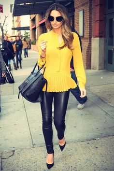 From theyallhateus.com (I'm a huge fan of black leather with yellow tops)