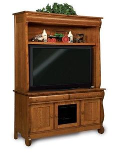Amish Vintage Sleigh Entertainment Center Unique sleigh style for your living room. This Vintage Sleigh Entertainment Center makes for a gorgeous viewing spot for family and friends. Solid wood and made in America. #entertainmentcenter
