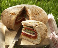Prepare sandwiches using loaves of crusty french bread filled with seasonal vegetables, local cheeses and meats. We love the look of this rustic artisan loaf. Simply slice off the top, fill with yummy ingredients, replace the top slice and Voíla! I Love Food, Good Food, Yummy Food, Pan Relleno, Great Recipes, Favorite Recipes, Creative Food, I Foods, Food Inspiration