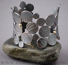 "Maria Samora, ""Non-Symmetrical Cuff,"" Sterling silver bracelet with sulfur patina finish and accent diamonds set in gold, at Blue Rain Gallery.  www.blueraingallery.com"