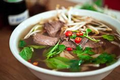 Fresh Vietnamese Pho, a rice noodle staple dish with ginger, lemongrass and chilies.