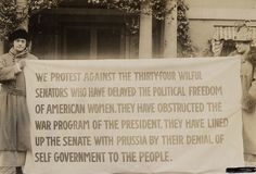 Two women holding a banner for women's suffrage in Washington D.C. in 1918. People used to protest so eloquently.