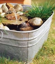Easy mini water feature in an old tub. Definitely on the to do list.