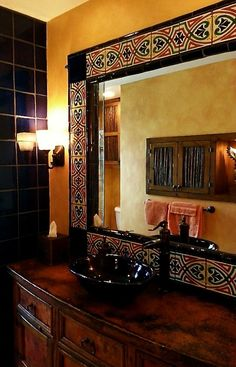 Dress up a mirror with Mexican tile to match your bathroom.