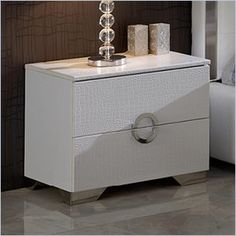 Dupen Coco Nightstand in White - This bedroom collection offers an elegant blend of traditional elements with modern simplicity of lines that produces a unique and rich flair perfect for any contemporary bedroom. The collection oozes a luxurious Hollywood chic that you can bring and enjoy in your own private haven.    Features: Two drawers Made in Spain  Specifications: Product Weight: 28lbs Overall Product Dimensions: 20H x 24W x 17D