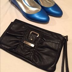 """I never use this clutch anymore! Simple black clutch. It has a place to store items in front, a zipper in the back, as well as built in card holders & a zipper inside. It's approximately 8 1/2"""" x 5 1/2"""". There are signs of use on the front buckle. Price reflects that. Thanks! Elle Bags Clutches & Wristlets"""