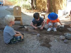Play is the work of the child in early childhood (nursery/preschool/kindergarten). Tucson Waldorf School students building a river dam in the play yard.
