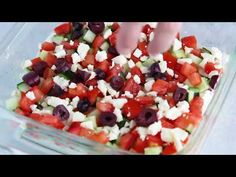 This Greek 7 Layer Dip is layered with hummus, yogurt, cucumbers, tomatoes, feta and olives. Grab a chip and serve this at your next party! You can prep all the