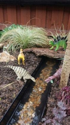 Dinosaur Garden - Everyone needs one of these - maybe add little army men .Dinosaur Garden - Everyone needs one of these - maybe add little army men! , needs this dino garden Window Art Dinosaur Garden, Outdoor Play Spaces, Outdoor Play Ideas, Sensory Garden, Preschool Garden, Backyard For Kids, Garden Kids, Garden Ideas Children, Baby Garden Ideas