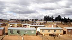 Reconstruction and Development Programme housing in Soweto, Johannesburg, South Africa Solar Powered Water Heater, Hills And Valleys, Affordable Housing, African Safari, Building Plans, Townhouse, Places Ive Been, South Africa, House Plans