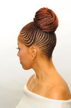 Feed In Cornrows in a bun. Braids by http://www.shorthaircutsforblackwomen.com/rock-killer-crotchet-braids-2015/ ~Latest African fashion, Ankara, kitenge, African women dresses, African prints, African men's fashion, Nigerian style, Ghanaian fashion ~DKK