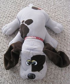 Vintage 80s Pound Puppies... mine has one ear hanging off and the eyes have rubbed off, still my pounder tho!