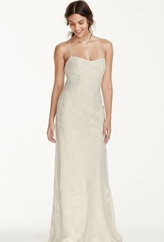 Galina Exclusively at David's Bridal. See more Galina gowns, exclusively at DavidsBridal.com��Lace sheath gown with spaghetti straps and low, lace-up back.