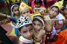 Indian children dressed as Hindu god Lord Krishna pose for a photograph at a fancy dress competition on the occasion of Janamashthami in Hyderabad on August 25, 2016.