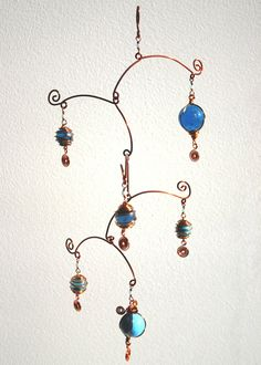 Hanging Mobile Stairs Sky - hanging mobiles - wire art - blue glass, copper wire, blue beads, hanging art, metal art. €40.00, via Etsy.