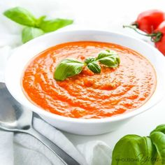 This 5-ingredient easy low carb tomato soup is bursting with roasted tomatoes & fresh basil. Low carb, gluten-free, grain-free & keto, with a paleo option.