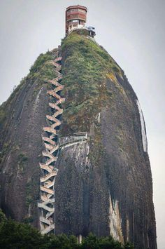 659 steps to the top: The Guatape Rock in Colombia. So want to go explore the world! Places Around The World, Oh The Places You'll Go, Places To Travel, Places To Visit, Around The Worlds, Stairway To Heaven, Wonders Of The World, The Good Place, Beautiful Places