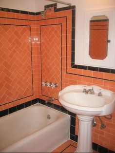 Salmon and black vintage tiles with pedestal sink. So adorable.