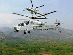 South African Air Force Denel Rooivalk attack helicopters in full combat support mode - here two are seen piloted by the South African Air Force whilst in United Nations livery. Attack Helicopter, Military Helicopter, Military Jets, Military Aircraft, Augusta Westland, South African Air Force, Air Force Aircraft, Aircraft Photos, Defence Force