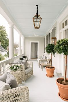 Betsy chose Janus et Cie janusetcie.com woven chairs for 86 Cannon's piazza. The furniture and paint colors are intentionally neutral to allow the original architecture of the house to shine, says Betsy.
